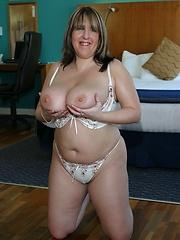 British, big tit MILF takes on a pair of cocks!