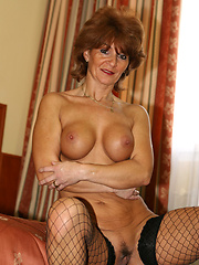 Tunde is the hottest granny you will ever see! Dressed in a sexy teddy and fishnet stockings she takes on a huge black cock