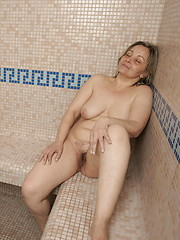 All is relaxed and well in this all female mature sauna