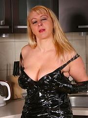 Blonde MILF getting kinky in her kitchen