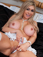 Hot MILF playing with her succulant body