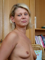 Lonely housewife is playing with a sex toy