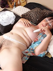 Older woman is playing with her hairy snatch