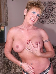 Horny old broad gets dusty pussy plugged!