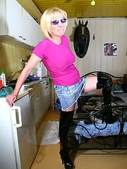 Blonde mature in dark leather boots