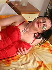 Sexy brunette mom in red top and black stockings