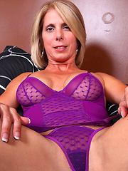 Jenny Mason teasingly flaunts her mature body in violet lingerie