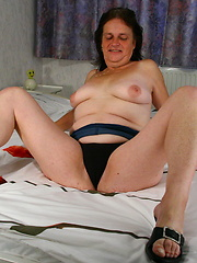 Perverted granny puts dildo into shaved hole