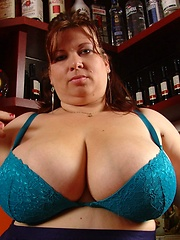 Busty plumper in tight bra and nylon stockings