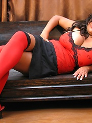 Busty latin chica Sofia in sexy tight bra and red stockings