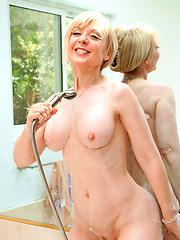 Horny blonde mom enjoying herself in the bath