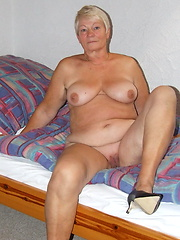 Busty granny loves her shaved pussy and satisfies herself