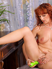 Nasty redhead mom putting green dildo into own shaved hole