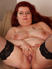 Big redhead woman puts her finger into own wet hole