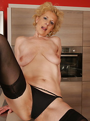 Blonde short-haired mom putting her fingers into her two tight holes