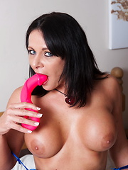 Hot brunette woman takes off her sexy lingerie for toy play