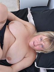 Big breasted mature BBW having fun by herself