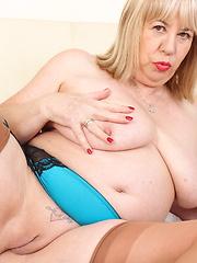 British big breasted mature BBW playing alone