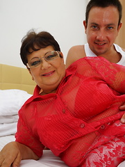 Naughty big mama playing with her toy boy