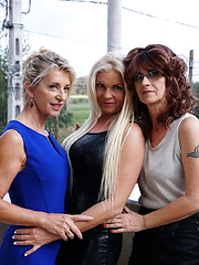 Three housewives making out on the bed