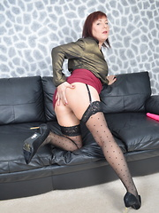 Naughty British housewife playing with her wet pussy on the couch
