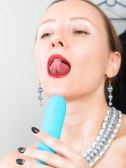 Solene Sol wears a new blue dress and masturbates