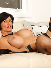 Beauty mature woman in black lingerie and stockings