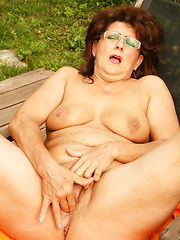 This big housewife gets naughty at the pool