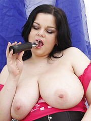 BBW babe with huge boobs giving a young boy some pleasure