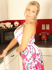 Sexy Milf Amber Lynn Bach strips in the kitchen and plays with her new toy.