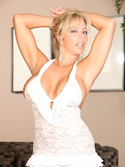 Amber Lynn Bach plays with her huge tits and licks her nipples.