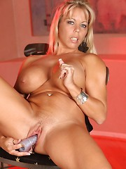 Amber Lynn Bach fucks her wet pussy with a new toy.