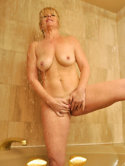 Dawn Jilling gets wet and wild as she rubs down her huge tits in the shower