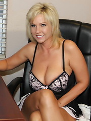 Alysha gets a little work done at the office with the blinds wide open