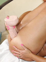 Naughty Alysha has some fun with some of her big toys