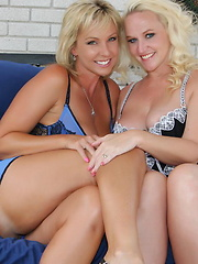 Two smokin hot blondes fist each others pussies