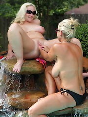 Alysha and Mrs Siren fist each other while relaxing in the pool