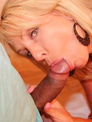 Big tittied blonde bouncing on a huge black cock
