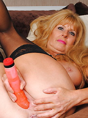 milf with big boobs showing her lovely body