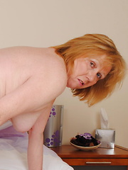 mature playing with a dildo
