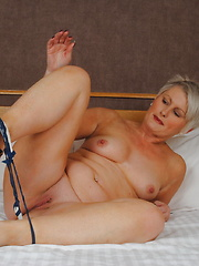 Naughty Housewife getting wet on her bed
