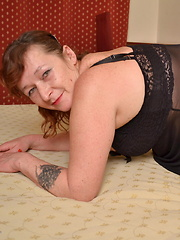 This horny mama loves to get wet on her bed