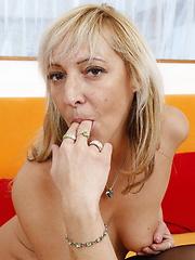 Blonde mature slut getting wet on her bed