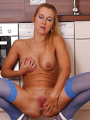 This hot MILF loves to get wet in her kitchen
