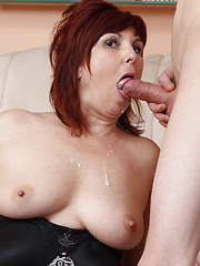 Naughty housewife playing with her boy toy