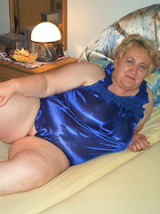 Naughty mama getting frisky on her bed