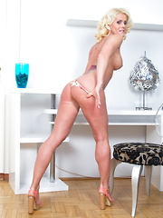 Hot blonde housewife getting ready to get wet