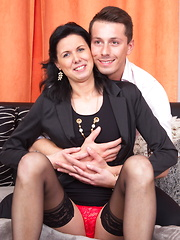 Naughty housewife playing with her toyboy