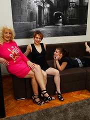 Three old and young lesbians make fun on the couch