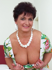 Naughty housewife playing with her luscious body